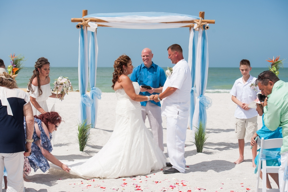 Congratulations Mr. and Mrs. Hamm. Wedding performed at Upham Beach with Gulf Beach Weddings