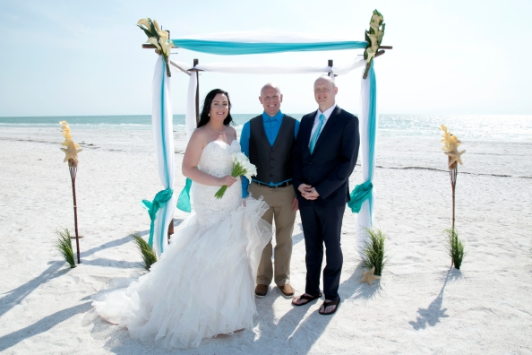 Congratulations Mr. and Mrs. McVika. Wedding performed at Pass-A-Grill Beach with Gulf Beach Weddings