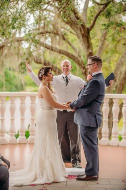 A outdoor wedding with their Love story at East Lake Woodlands Country Club