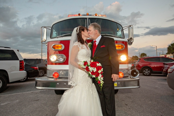 Former fire Chief and Wife at Clearwater beach wedding with Gulf Beach Weddings and photos by Koz for Celebration.