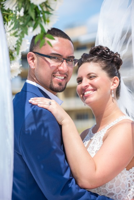 Perfect beach wedding with Gulf Beach Weddings and Louis Photography.